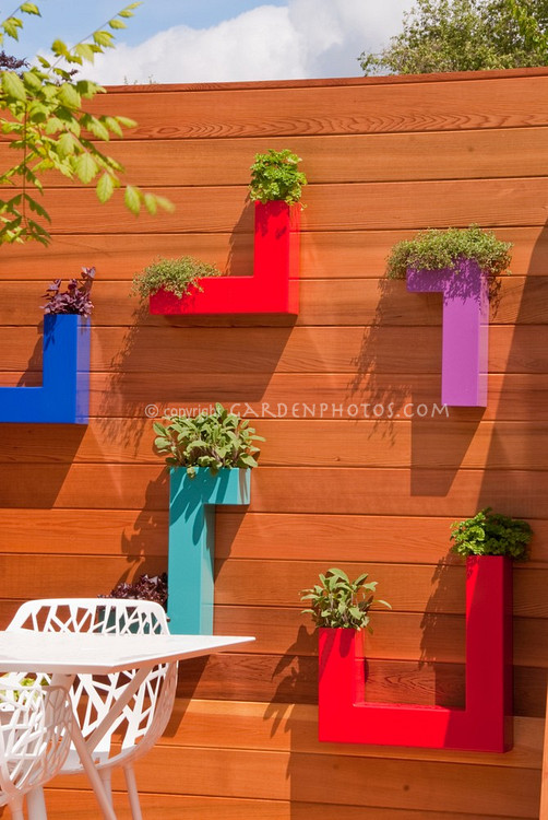 Deck potted plant society for Balcony herb garden designs containers